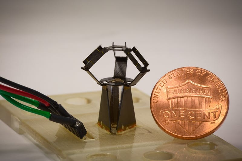 MilliDelta Robot for Performing Industrial Micromanipulations and Microscopic Surgeries